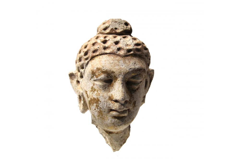 Gandharan Head of a Buddhist Subject in stucco and gold leaf
