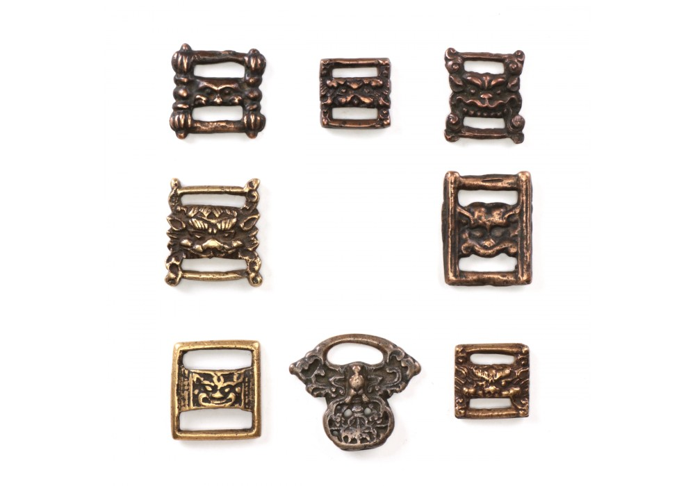 Lot of 8 Tibetan Thokchas Amulets and Sutra Clasps in bronze