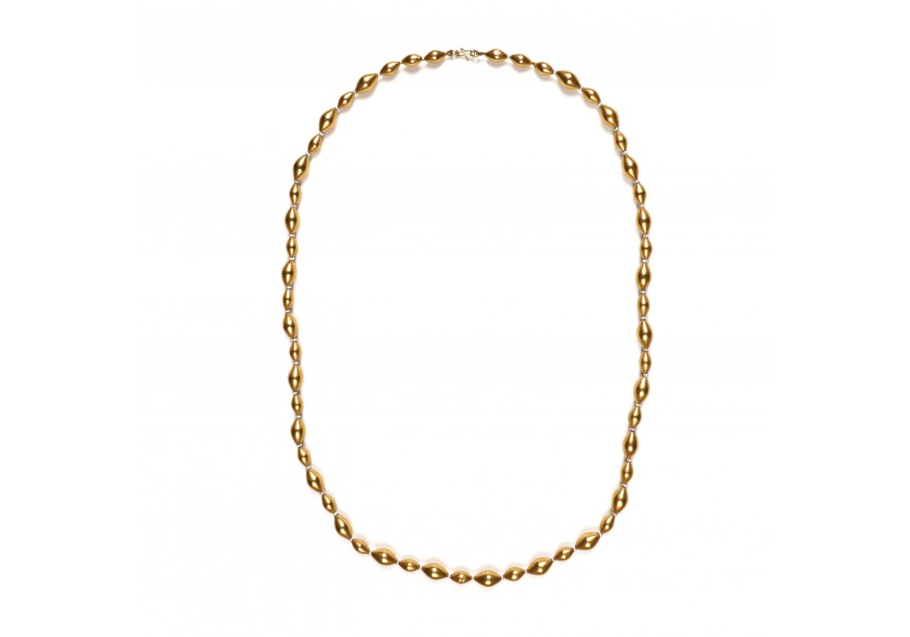 Indian necklace of wax beads covered with gold leaves