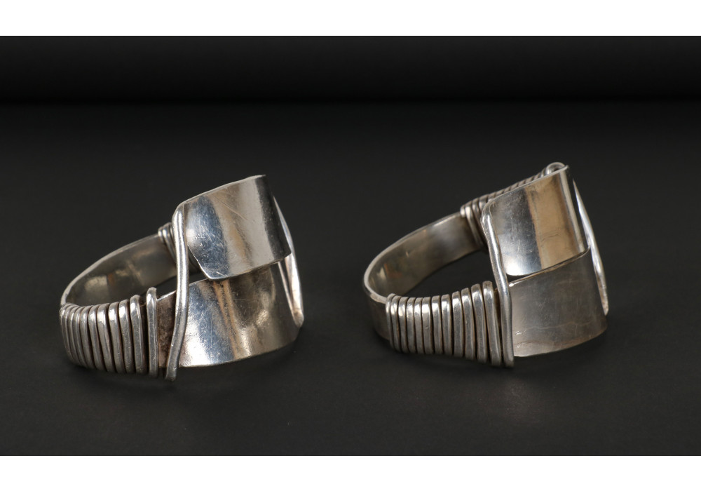 Pair of silver bracelets with spiral work