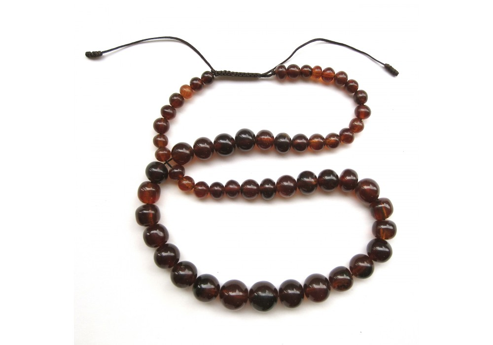 Necklace in graduated spherical amber Beads