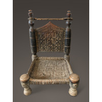 Carved low chair from North-West Pakistan
