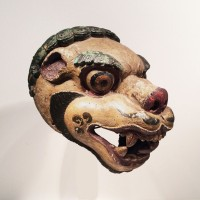 Tibetan polychromed wood Mask of a Lion with large brows and a mane of curled fur