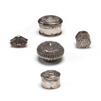 Small silver Betel box containing narrative and flowery scenes in repoussé