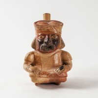 Peruvian Moche-Nazca Spout Bottle shaped in a seated figure