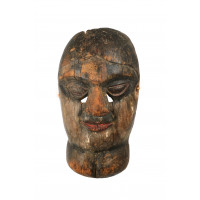Nepalese mask representing a woman with a goiter