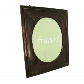 A wood Frame with an original oval shaped wood passe-partout