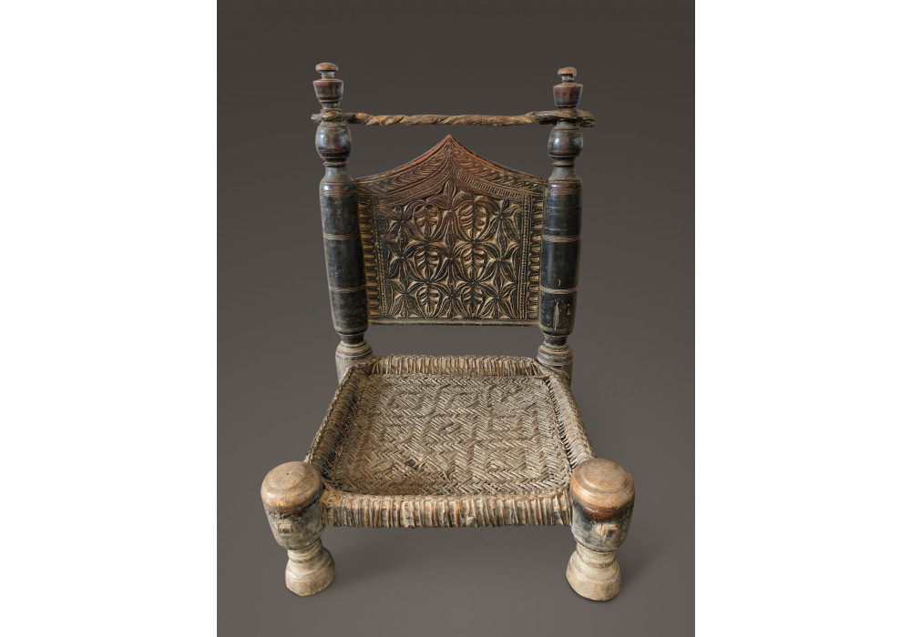 Carved low chair from Nort-West Pakistan