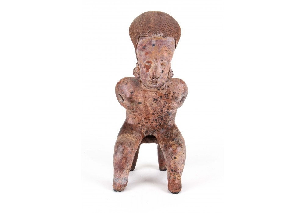 Large sitting figure with hands on chest