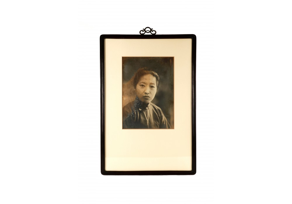 Framed ancestral portrait of a woman