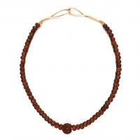 ISA B // Necklace with brown melon glass beads and a Chinese lacquered nut