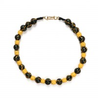 ISA B // Necklace with very rare yellow raised eyes beads and black feather beads