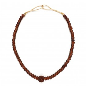 Necklace with brown melon glass beads and a lacquered nut